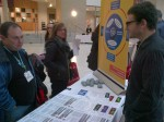 Isaac Coplan engaging with stakeholders at NeuroDevNet booth